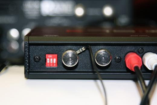 Set the dip switches -  Up for Phono, down for line
