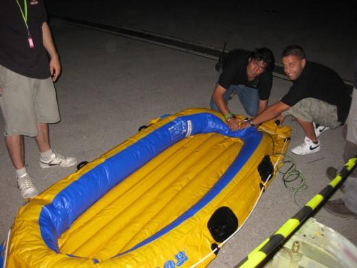 backstage inflating Steve Aoki's life boat